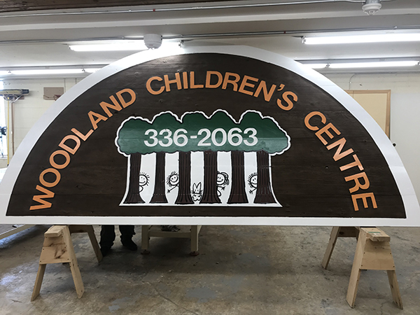 A brand new child care building sign